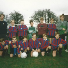East Meon juniors football team, managed by Jeff  Wheeler.(back row, left) and Martin Cooke (right). Team, left to right, back row, WIlliam Normandale, Adrian Powney, Wayne Harfield, Jason Thorne, Joe North. Front row, Adam Dowlen, Stewart Powney. James Gough,Andrew Blackman Wayne Carter, Sam North.