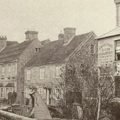 East Meon High Street, New Inn on right (note Alton Brewery owns it). Well-head on what is now Washers Triangle at front