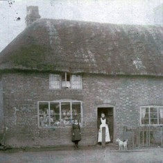 Mrs Potter outside Potter's General Warehouse, 1911. She took over the business when her husband died.