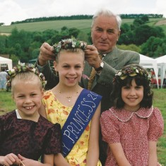 Wilson Atkinson crowns Emily Cross as May Queen, with her sister Amy in attendance (left)