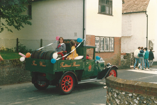 Decorated truck in procession past Bell Cottage