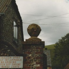 Gatepost and garage sign