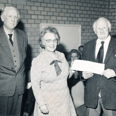 Herbie Goddard receives certificate from his successor, Betty Tucker, March 1981.
