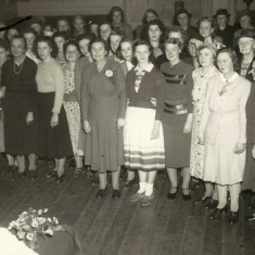 Large group of ladies with cake