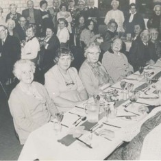 Luncheon Club in VIllage Institute, date unknown.  Kit Tubb, Marion Blackman, Rods Mauback, …. Marjorie Lambert,Thelma Hoare Sylvia Whittear, Daisy & Fred Gibbs, Mrs Tee, Jean Blackman, Kath Adams, Nellie Goddard, Pam Goddard, another, Mrs Porch, Jessie Crockford, Mrs Ivy Blackman