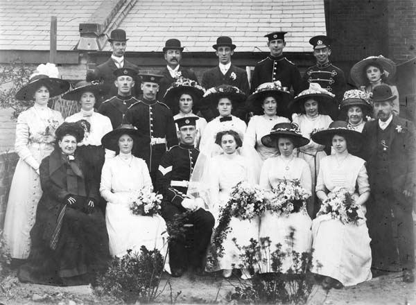 Wedding of Owen Budd to Mabel Stone in 1912. Back row: William Newbold, Arthur Budd, George Stone, Crispin Budd, John (Jack) Newbold, Dorothy Newbold. Centre row: Florence Budd, Edith Budd, Fred Hutty (Edith's husband); Jess Vince, ? ? (one of them possibly Alice Stone, mother of the bride); Sophia Budd, Emily Newbold (daughter), Emily Newbold, nee Budd (mother), George Stone (Owen's father in law). Front row: Sophia Harriet Budd (Owen's mother), Winifred Newbold, Owen Budd, Mabel Budd, nee Stone (Owen's wife), Bertha Stone,? .