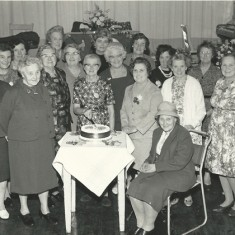 WI with cake. Back row, Ivy Cook, Shirley Kitcher, Mrs Bray, Nurse Day, Eileen Atkinson, Loreie Wilmot-Smith. 2nd row Audrey Street, Mrs Clitheroe, Mrs Aislewood, Rachel Mackinlay, Lettice Ross, Beryl Knight, Mrs Kille, Iris Porter. Front, Clarrie Fisher, Marion Lambert, Phyllis White, Dorrie Fisher