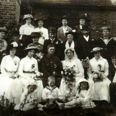 Information from Denise Moody: They both came from large families but no one has a clue who the other people are in the photo except Granny and Grandad Bone, he is in his army uniform and of course Granny in her wedding dress plus both sets of parents - Grandad Bones behind him with his Mum to the left and his Dad beside her further to the left. Granny Bone's parents are directly behind the bride and groom.