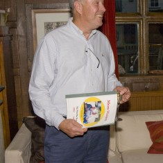Chris Brough, the founding editor, with the presentation booklet