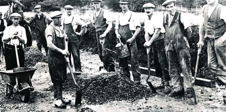 Leydene gardeners building the driveway, c 1930.  Jack Cook is fourth from left in the front row.