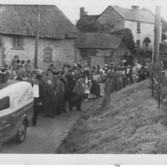 Coronation procession marches past Riverside, 1953. Lodge of Ancient Order of Foresters, Jack Pollard leading, Stuart Pollard on donkey, front row Hack Appleby, Herbie Goddard, Fred Gibbs. Jack Cook near back, wearing cap.