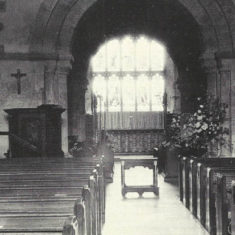 Black and white image of the nave, showing the East window. Date unknown but post 1921.