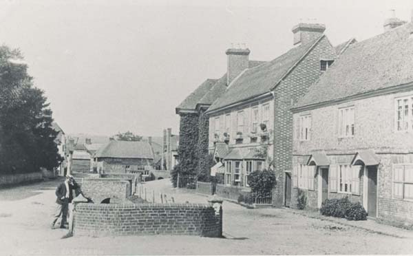 Post card to the High Street, with what are now Francis and Clare Cottages in the right.
