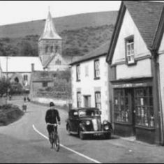 Cycling past Post Office in Church Street