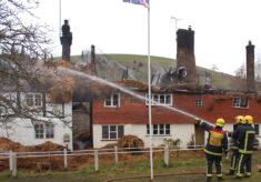 Firemen hosing Hockley and Brook Cottages