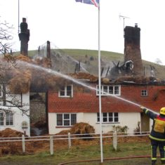 Firefighters and appliances after the first fire at Brook and Hockley cottages, March 2009.