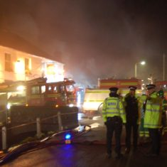 Firefighters and appliances at the first fire at Brook and Hockley cottages, March 2009.