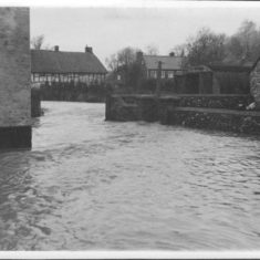 Flood  across bridge and beamed cottages, possibly car park at New Inn. Collection of '50s photos at Ye Olde George.