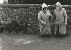 George and Jean Samways on flooded street
