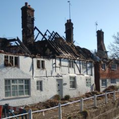 The remains of the second thatch fire at Hockley & Brook Cottages, 2013. | Michael Blakstad