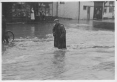 Man walking through Floodwater