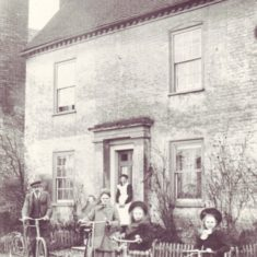 Nurse Micklam and family outside Barnards