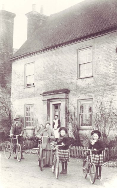 Nurse Micklam and family outside Barnards