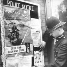 Outside Police Station with posters
