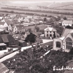 Almshouses had been built on the eastern side of Church Street in 1904. No cottage in church yard, and the rifle range had been built at the institute (top left) so post 1918.
