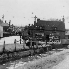 River, Pinks store and war memorial covered in bunting for the Coronation of Elizabeth II in June 1953
