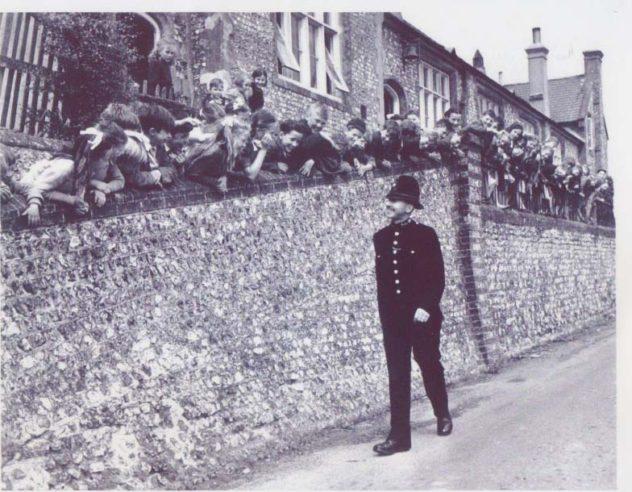 Schoolchildren along the School Wall