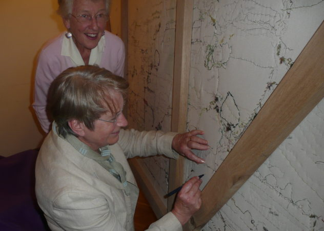 Tricia Blakstad signing the Millennium Tapestry