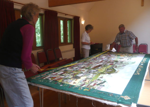 Stretching the Millennium Tapestry canvas onto an oak frame