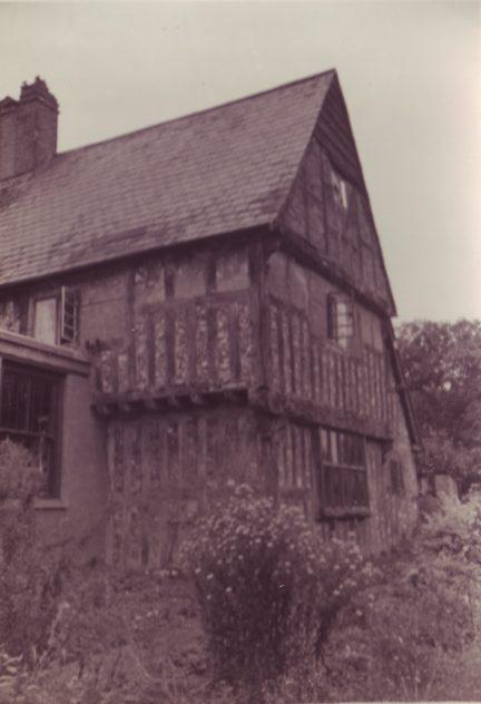 Tudor House with bush and shop