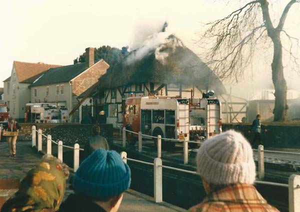 February 1996, villagers help Commander Page evacuate his house.