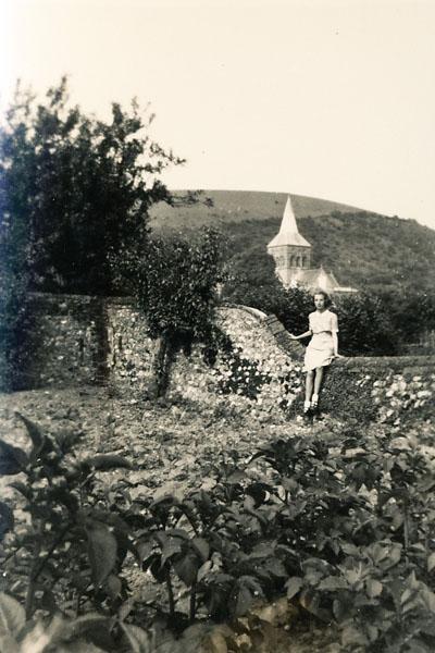 Olivia Woodfield on the Tudor House garden wall