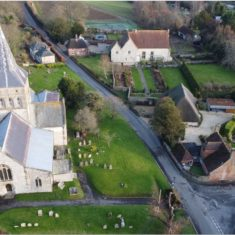 Drone photograph by showing the church and the church hall, barn, and the cottage, barn and gardens at The Court House  | Richard Gaisford