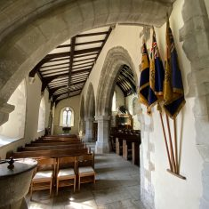 South nave & Early English arches.  Colours of HMS Mercury on wall. | Richard Gaisford
