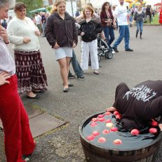 Apple bobbing, supervised by Clare Bartlett