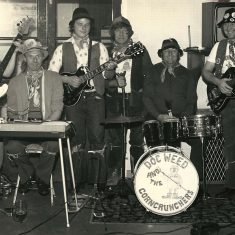 Doc Weed and the Corncrunchers. L - R Geoff Marshall, David Goddard, Robby Hamilton, Noel Stone, (Coalman, West Meon) John Mundy, Les Blackman