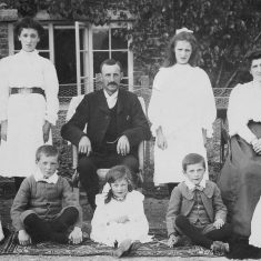 The Atkinson family in front of South Farm. Centre, George Atkinson. Left to right, back row, Hilda (Wren), Nellie (Hoskings) middle, Ethel (Hobbs), Mary Wilson; front, George, Millie, Joseph, Elizabeth.