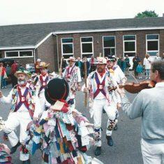 Morris dancers and fiddler